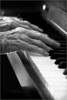 My friend Agnes graciously played the piano over and over while I experimented on trying to get the right combination of sharp photo with slightly blurred hands (from the motion of playing). She said it was fun! Thanks, Agnes! This is one photo that I think works so much better in b&w than it did in color.